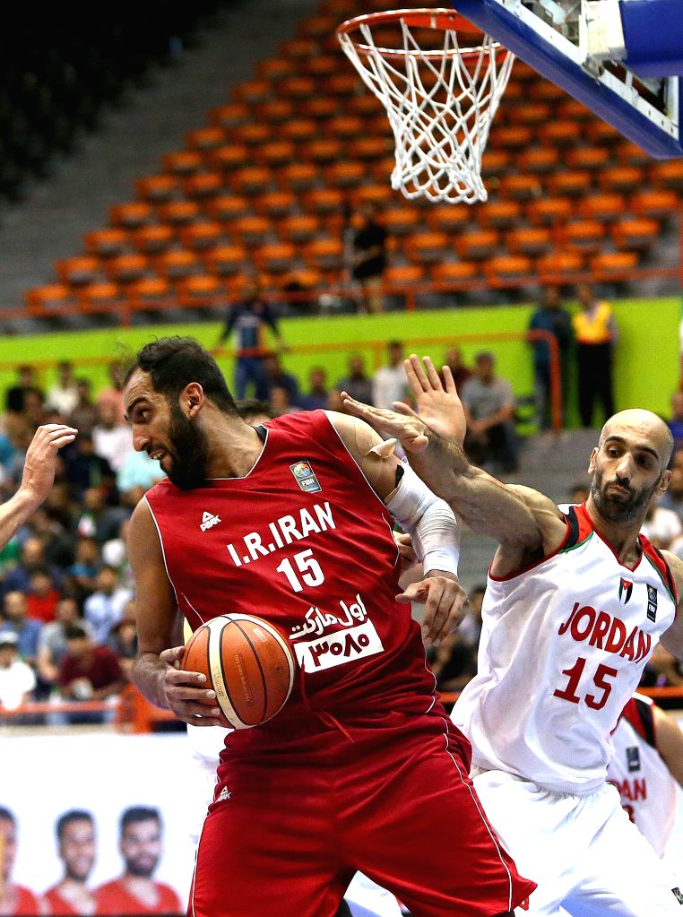 TEHRAN, Sept. 18, 2016 - Hamed Haddadi (L) of Iran competes during the semifinal match against Jordan at the 2016 FIBA Asia Challenge in Tehran, Iran, Sept. 17, 2016. Iran won 74-63.
