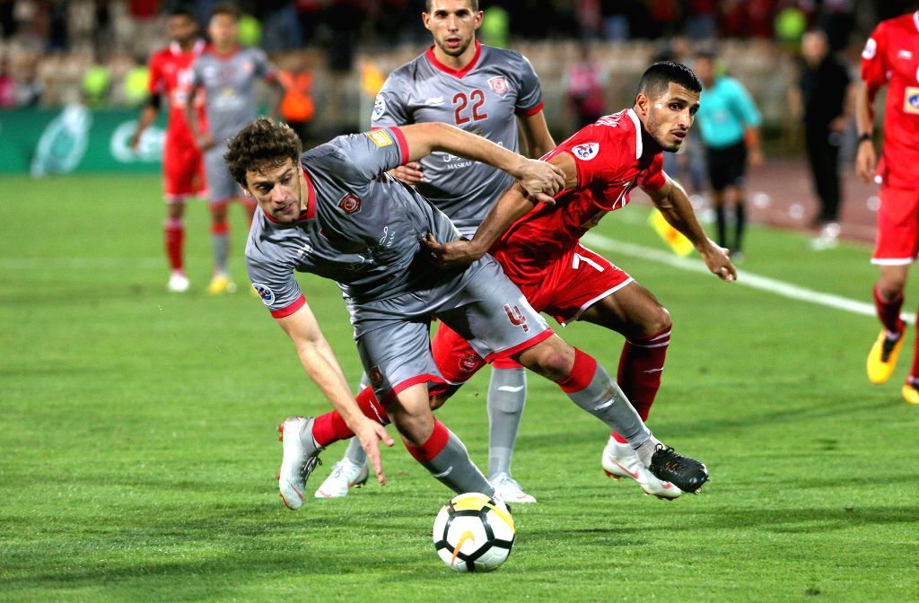 TEHRAN, Sept. 18, 2018 - Ali Alipour (R) of Persepolis vies with Lucas Mendes of Al Duhail during the AFC Asian Champions League quarterfinal second leg football match between Iran's Persepolis and ...