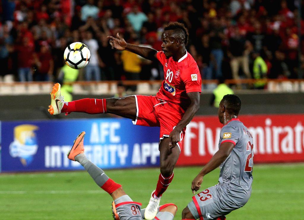 TEHRAN, Sept. 18, 2018 - Godwin Mensha (Top) of Persepolis competes during the AFC Asian Champions League quarterfinal second leg football match between Iran's Persepolis and Qatar's Al Duhail in ...
