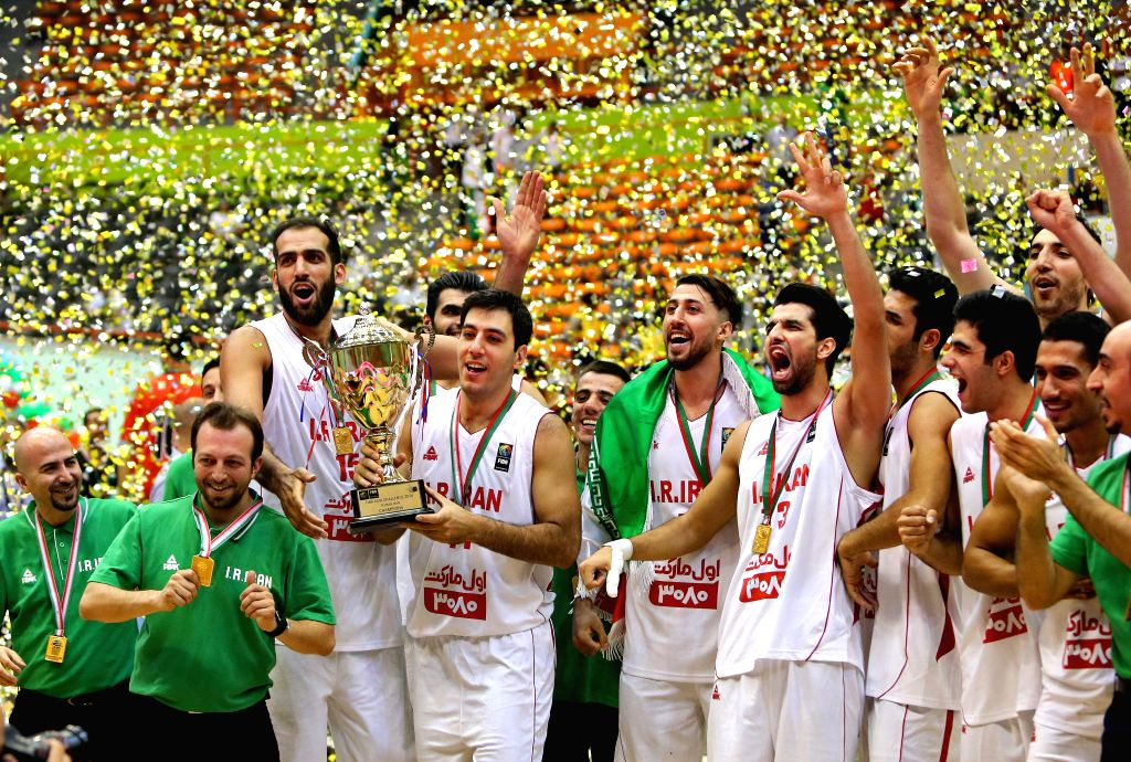 TEHRAN, Sept. 19, 2016 - Iranian players celebrate during the awarding ceremony of the 2016 FIBA Asia Challenge in Tehran, Iran, Sept. 18, 2016. Iran won the champion after defeating South Korea ...
