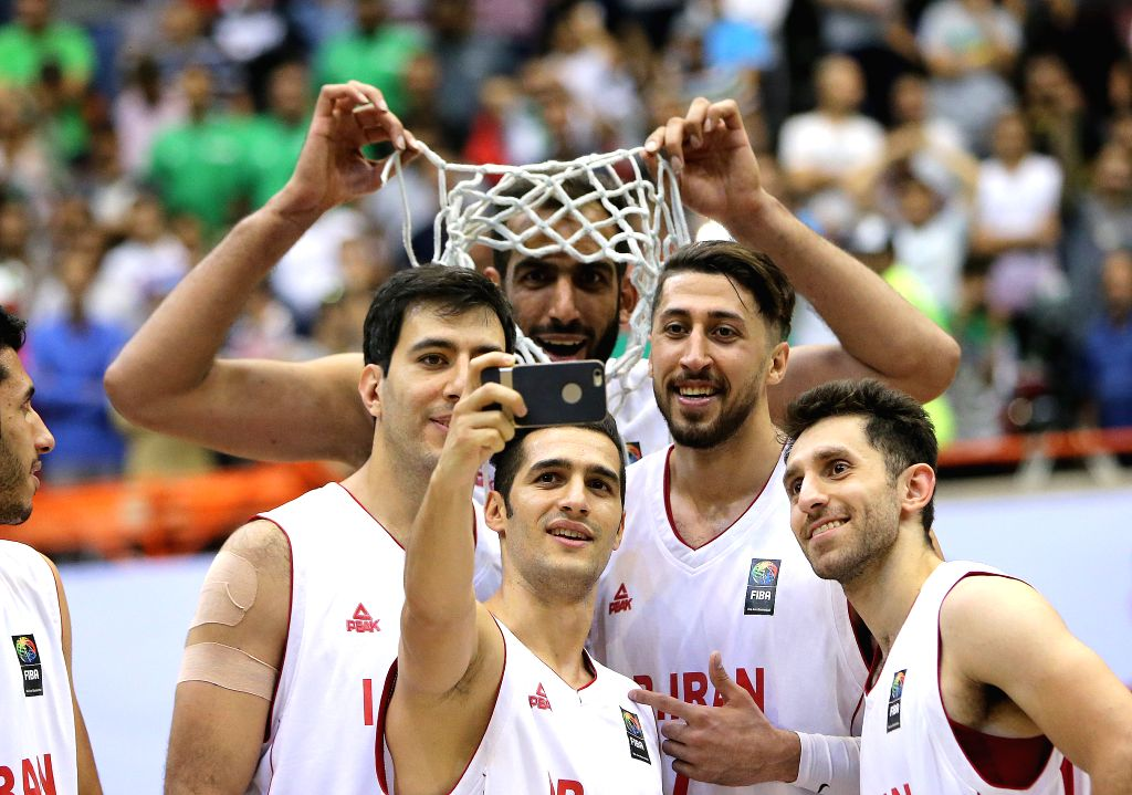 TEHRAN, Sept. 19, 2016 - Iranian players take a selfie during the awarding ceremony of the 2016 FIBA Asia Challenge in Tehran, Iran, Sept. 18, 2016. Iran won the champion after defeating South Korea ...