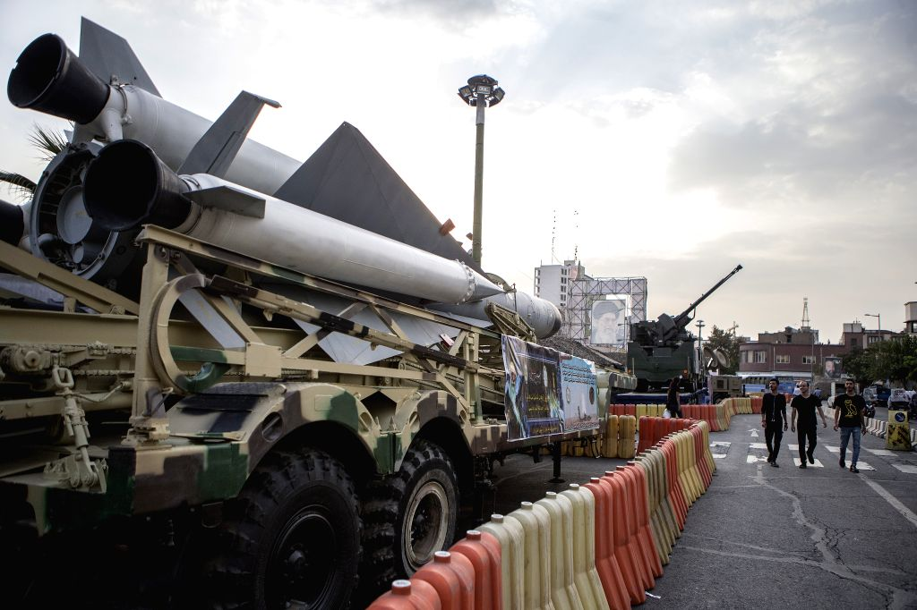 TEHRAN, Sept. 29, 2019 - People walk past missiles on display for the Defense Week in Tehran, Iran, on Sept. 29, 2019. The Defense Week was held here recently to mark the 39th anniversary of the ...