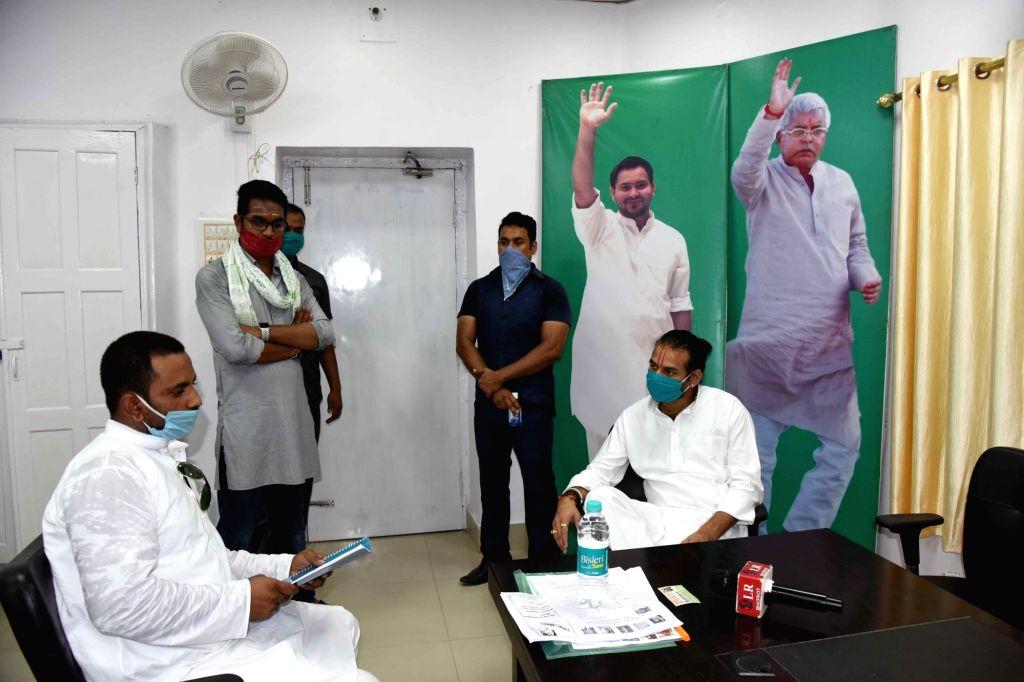 Tej Pratap Yadav meets Party candidate at Party Office in Patna on August 30, 2020. - Tej Pratap Yadav