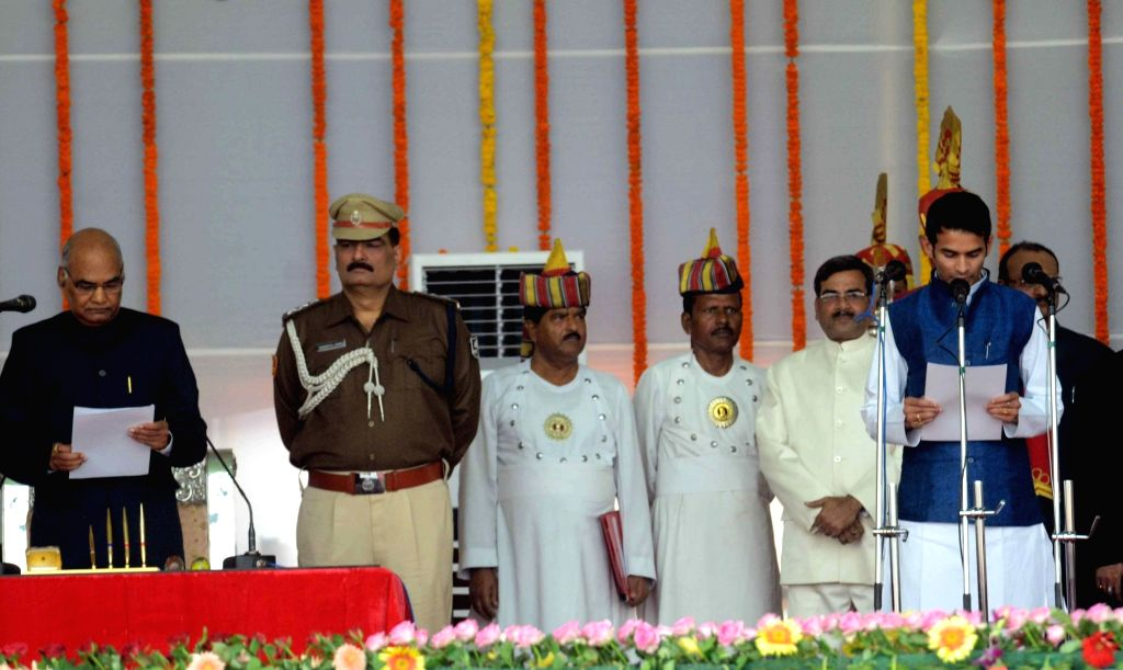Tej Pratap Yadav takes oath as a cabinet minister during the swearing-in ceremony of the new JD-U-RJD-Congress coalition government in Patna, on Nov 20, 2015. - Tej Pratap Yadav