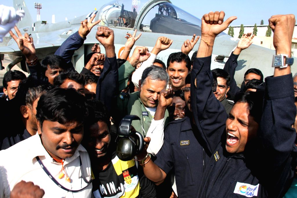 `Tejas` team celebrates as  indigenously-designed `Tejas`, regarded as the smallest and the lightest combat jet in the world, after it passed initial operational clearance (IOC-II) test in Bangalore .