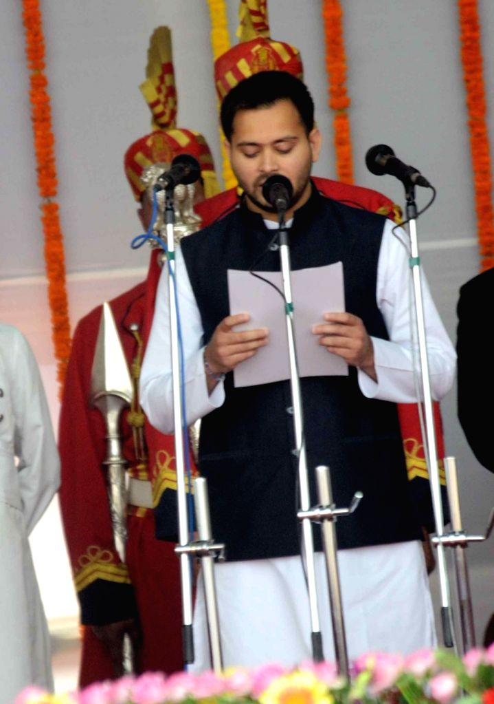 Tejashwi Yadav takes oath as a cabinet minister during the swearing-in ceremony of the new JD-U-RJD-Congress coalition government in Patna, on Nov 20, 2015. - Tejashwi Yadav