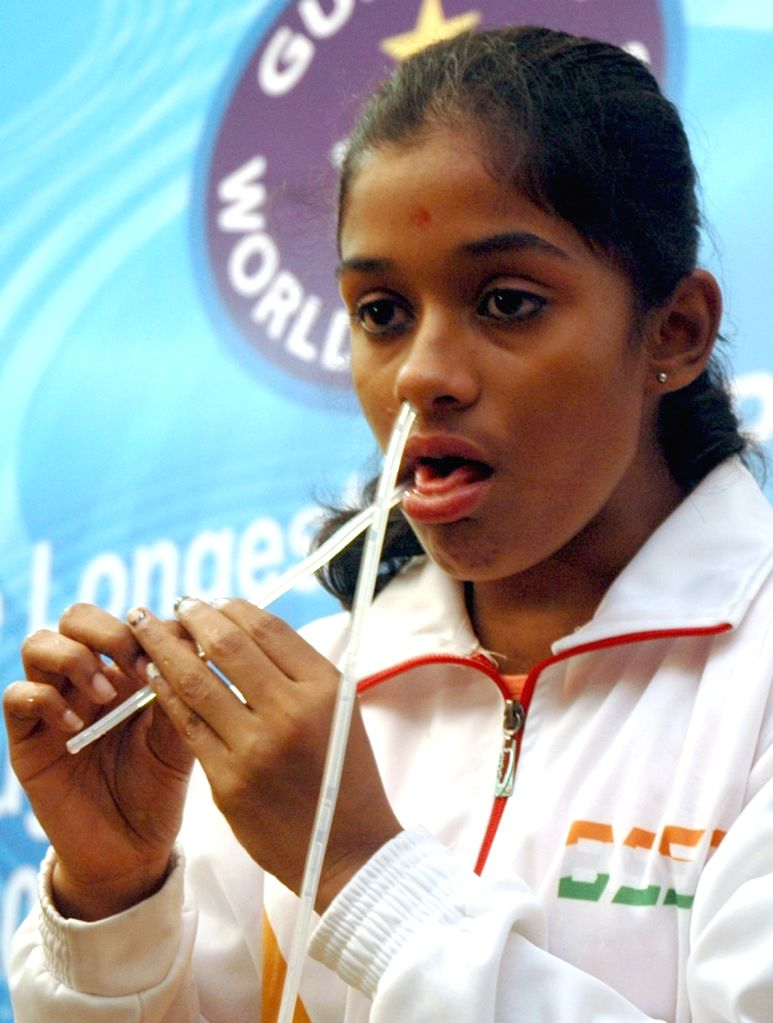 Tejaswini Girish from Karnataka who created the record of longest string passed through nose and mouth in 30 seconds, a unique world record measuring length 87,84 feet to create a Guinness ...
