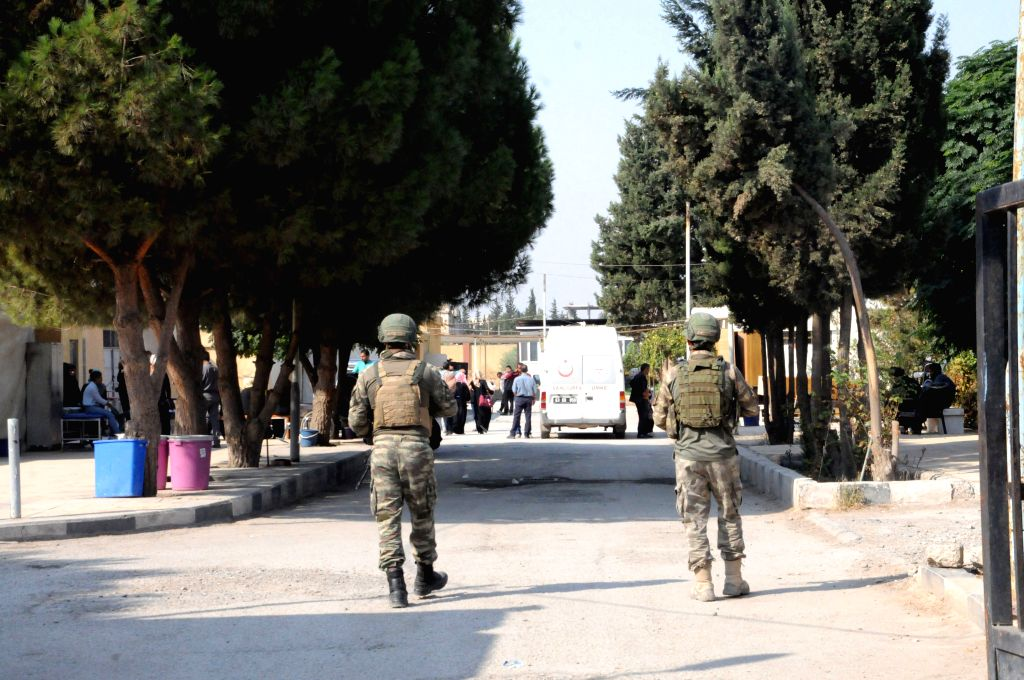 TEL ABYAD (SYRIA), Oct. 27, 2019 Members of the Turkish forces and allied Syrian rebels patrol in Tel Abyad, Syria, Oct. 27, 2019. A Turkish soldier was killed and five others wounded in ...