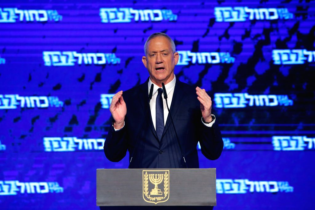 TEL AVIV, April 11, 2019 - Benny Gantz, the main leader of the Blue and White party and a former chief of the Israeli forces, speaks to supporters in Tel Aviv, Israel, on April 9, 2019. The Blue and ... - Benjamin Netanyah