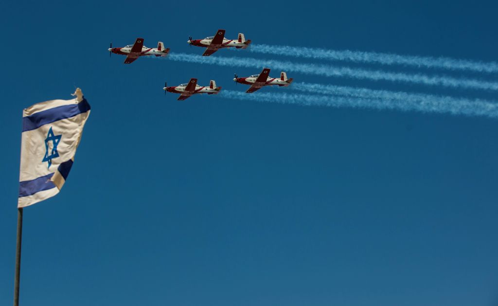Israeli air force airplanes attend an air show marking the Independence Day above the Mediterranean Sea in Tel Aviv, Israel, on April 23, 2015. Beginning at ...
