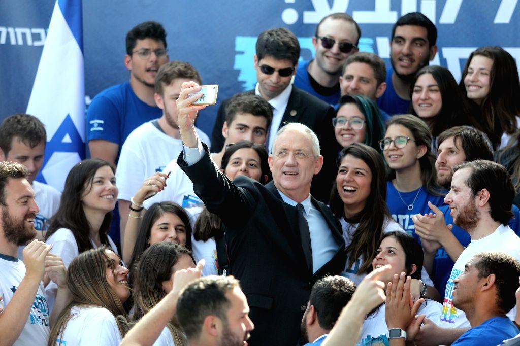 TEL AVIV, April 9, 2019 - Benny Gantz (C in suit) takes part in a campaign event in Tel Aviv, Israel, on April 8, 2019, a day ahead of the electoral polls. Benny Gantz, ex-chief of the Israeli ... - Benjamin Netanyah