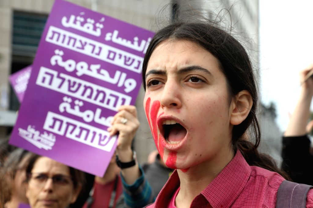 TEL AVIV, Dec. 12, 2018 - A human rights activist protests against violence toward women in Tel Aviv, Israel, on Dec. 12, 2018. After a woman was stabbed to death on Tuesday in her home, a total of ...