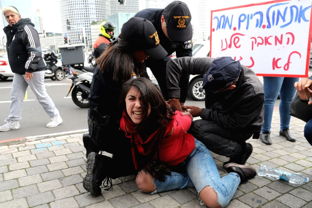 TEL AVIV, Dec. 12, 2018 - A human rights activist is detained by police officers during a protest against violence toward women in Tel Aviv, Israel, on Dec. 12, 2018. After a woman was stabbed to ...