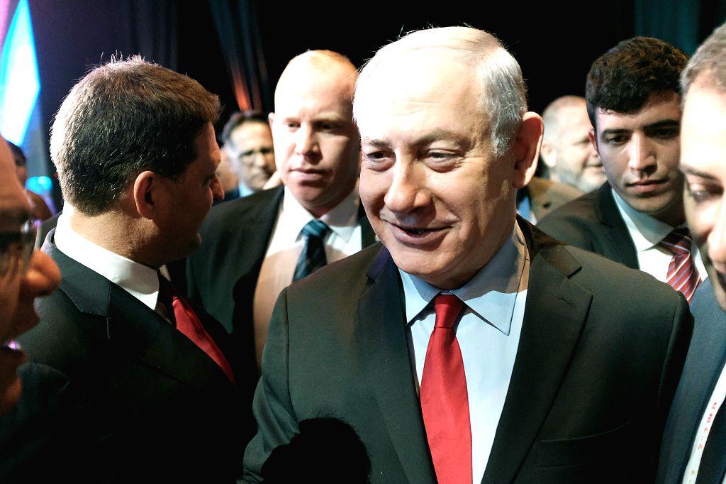 TEL AVIV, Feb. 14, 2018 - Israeli Prime Minister Benjamin Netanyahu (C) attends a conference on smart city challenges and threats in Tel Aviv, Israel, on Feb. 14, 2018. Israeli Prime Minister ... - Benjamin Netanyahu