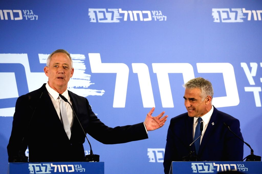 TEL AVIV, Feb. 21, 2019 - Benny Gantz (L) and Yair Lapid react as they deliver a joint statement in Tel Aviv, Israel, on Feb. 21, 2019. Israeli Prime Minister Benjamin Netanyahu's main challengers ... - Benjamin Netanyah