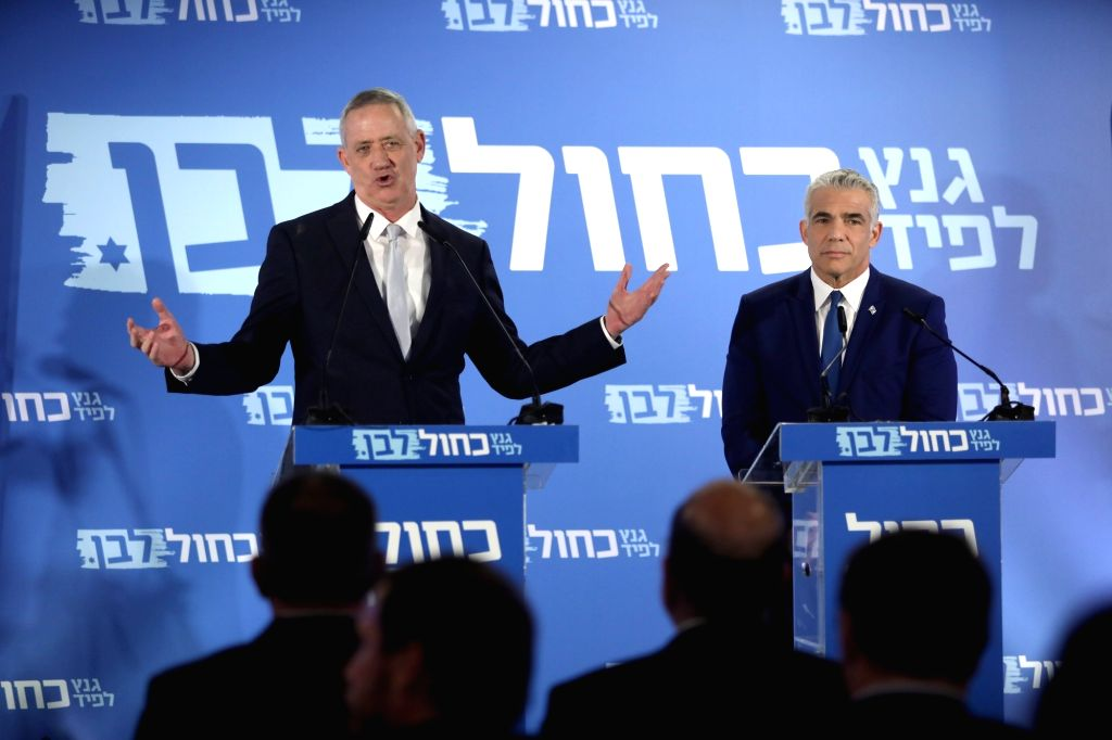 TEL AVIV, Feb. 21, 2019 - Benny Gantz (L, Rear) and Yair Lapid (R, Rear) react as they deliver a joint statement in Tel Aviv, Israel, on Feb. 21, 2019. Israeli Prime Minister Benjamin Netanyahu's ... - Benjamin Netanyah