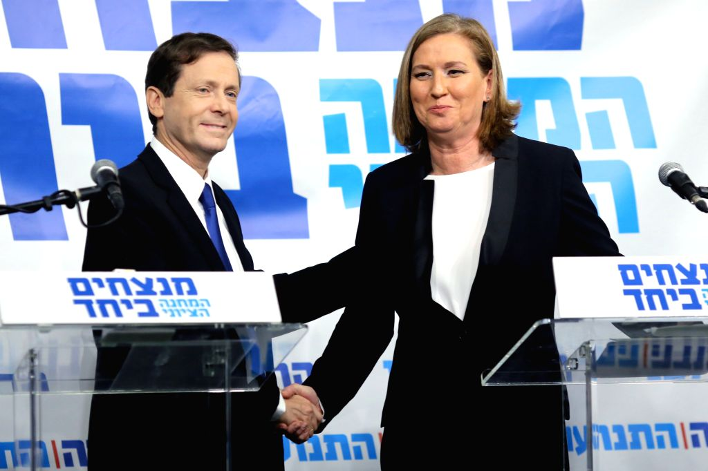 Tel Aviv: Israeli Labor Party chief Yitzhak Herzog (L) shakes hands with Israel's former justice minister Tzipi Livni during a press conference in Tel Aviv, Israel, on Dec. 10, 2014. Israel's former . - Tzipi Livni