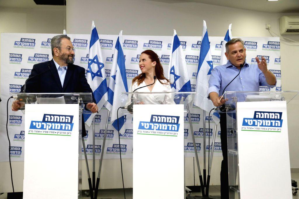 TEL AVIV, July 25, 2019 - Former Israeli Prime Minister Ehud Barak (L) attends a press conference with Stav Shaffir (C), a senior female lawmaker with the Labor party, and Nitzan Horowitz, Chairman ... - Ehud Barak