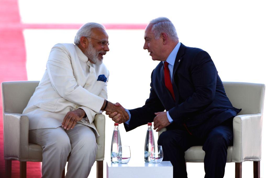 TEL AVIV, July 4, 2017 - Israeli Prime Minister Benjamin Netanyahu (R) shakes hands with Indian Prime Minister Narendra Modi at Ben Gurion International Airport outside Tel Aviv, Israel, on July 4, ... - Benjamin Netanyahu and Narendra Modi
