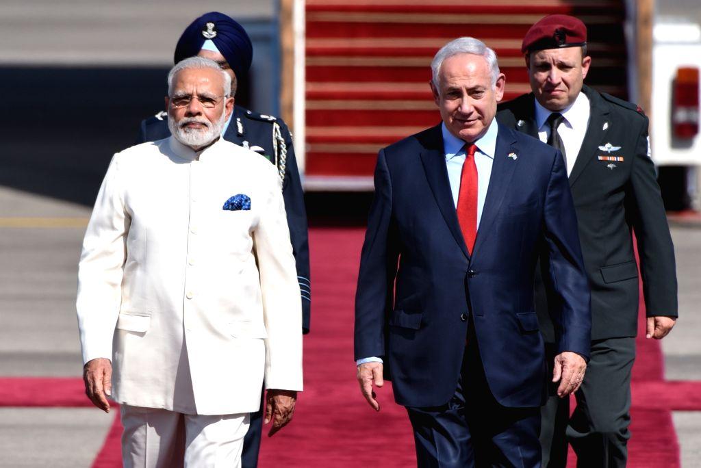 TEL AVIV, July 4, 2017 - Israeli Prime Minister Benjamin Netanyahu (R, Front) welcomes Indian Prime Minister Narendra Modi (L, Front) at Ben Gurion International Airport outside Tel Aviv, Israel, on ... - Benjamin Netanyahu and Narendra Modi