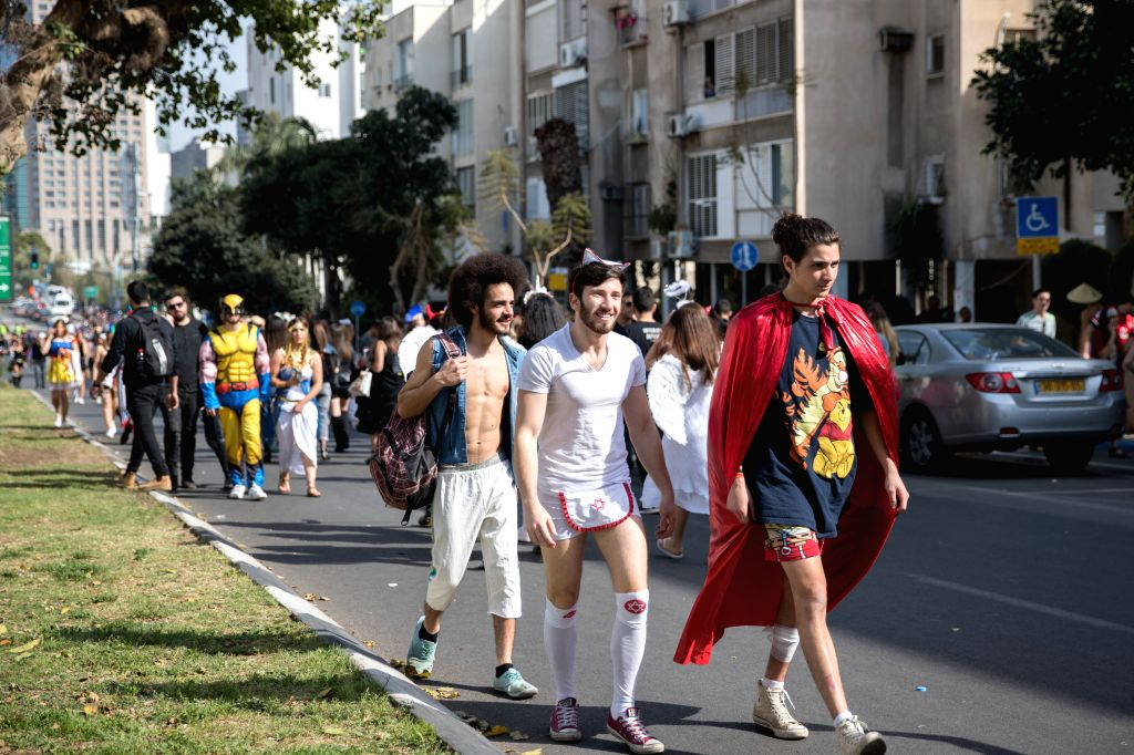 TEL AVIV, March 10, 2017 - People attend the Tel Aviv Purim Festival street party in downtown Tel Aviv, Israel, on March 10, 2017. Purim is a Jewish holiday that commemorates the deliverance of the ...