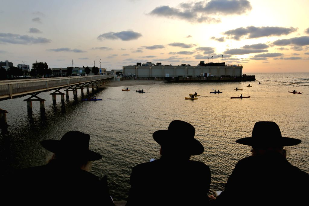 TEL AVIV, Oct. 10, 2016 - Ultra-Orthodox Jews pray as they take part in Tashlich on the shore of the Mediterranean Sea in Tel Aviv, Israel, Oct. 9, 2016. Tashlich is a ritual during which believers ...