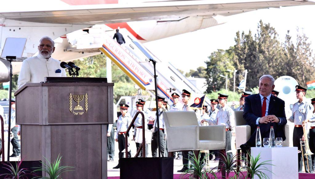 Tel Aviv: Prime Minister Narendra Modi addresses a press conference on arrival in Tel Aviv, Israel on July 4, 2017. Also seen Israeli Prime Minister Benjamin Netanyahu. - Narendra Modi