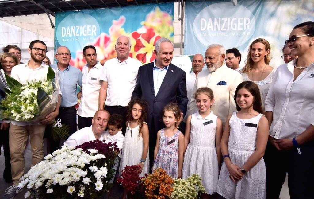 Tel Aviv: Prime Minister Narendra Modi and Israeli Prime Minister Benjamin Netanyahu visit the Danziger Flower Farm - a leading facility for R&D in plant varieties; in Tel Aviv, Israel on July 4, ... - Narendra Modi