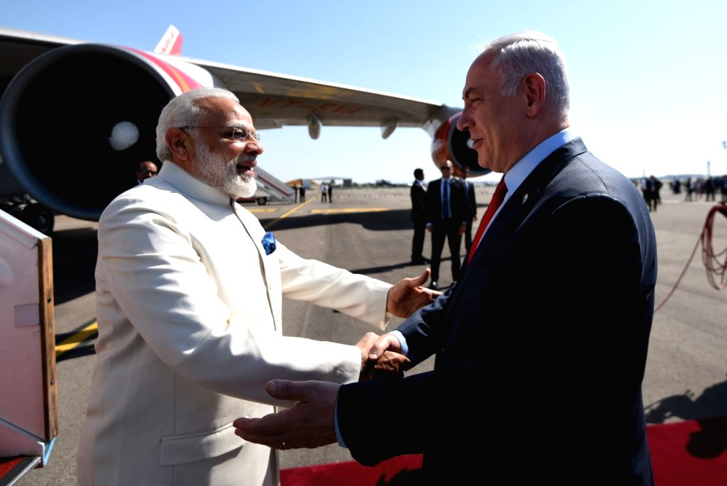 Tel Aviv: Prime Minister Narendra Modi being received by Israeli Prime Minister Benjamin Netanyahu on his arrival at Ben Gurion Airport in Tel Aviv, Israel on July 4, 2017. - Narendra Modi