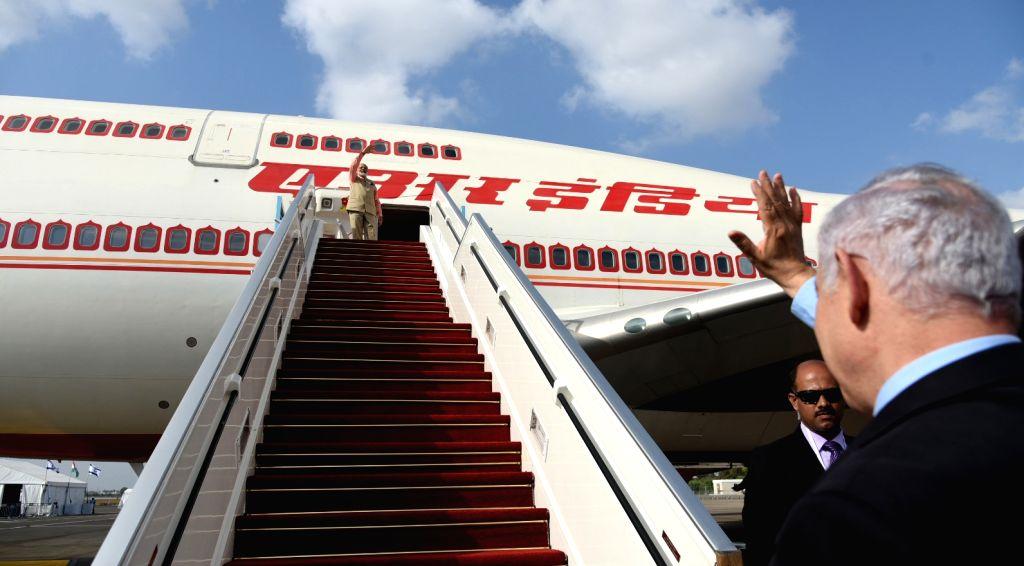 Tel Aviv: Prime Minister Narendra Modi being seen off by the Israeli Prime Minister Benjamin Netanyahu as he emplanes for Hamburg, Germany from Israel;  in Tel Aviv, Israel on July 6, 2017. - Narendra Modi
