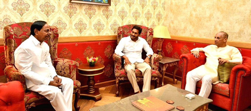 Telangana and Andhra Pradesh Chief Ministers K. Chandrashekhar Rao and Y. S. Jagan Mohan Reddy call on the Governor of both Telugu states E. S. L. Narasimhan, in Hyderabad on June 1, 2019. - K. Chandrashekha