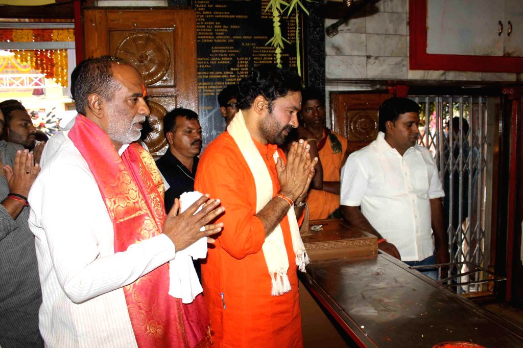 Telangana BJP chief G. Kishan Reddy offers prayers at a temple during Bonalu in Hyderabad on July 20, 2014.