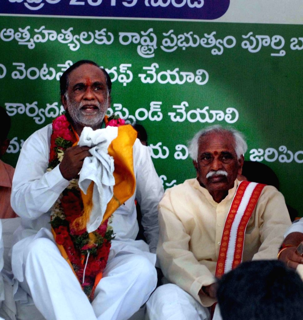 Telangana BJP chief K. Laxman with party leader Bandaru Dattatreya during his indefinite fast to protest against the massive bungling in Intermediate examination results, in Hyderabad on ...
