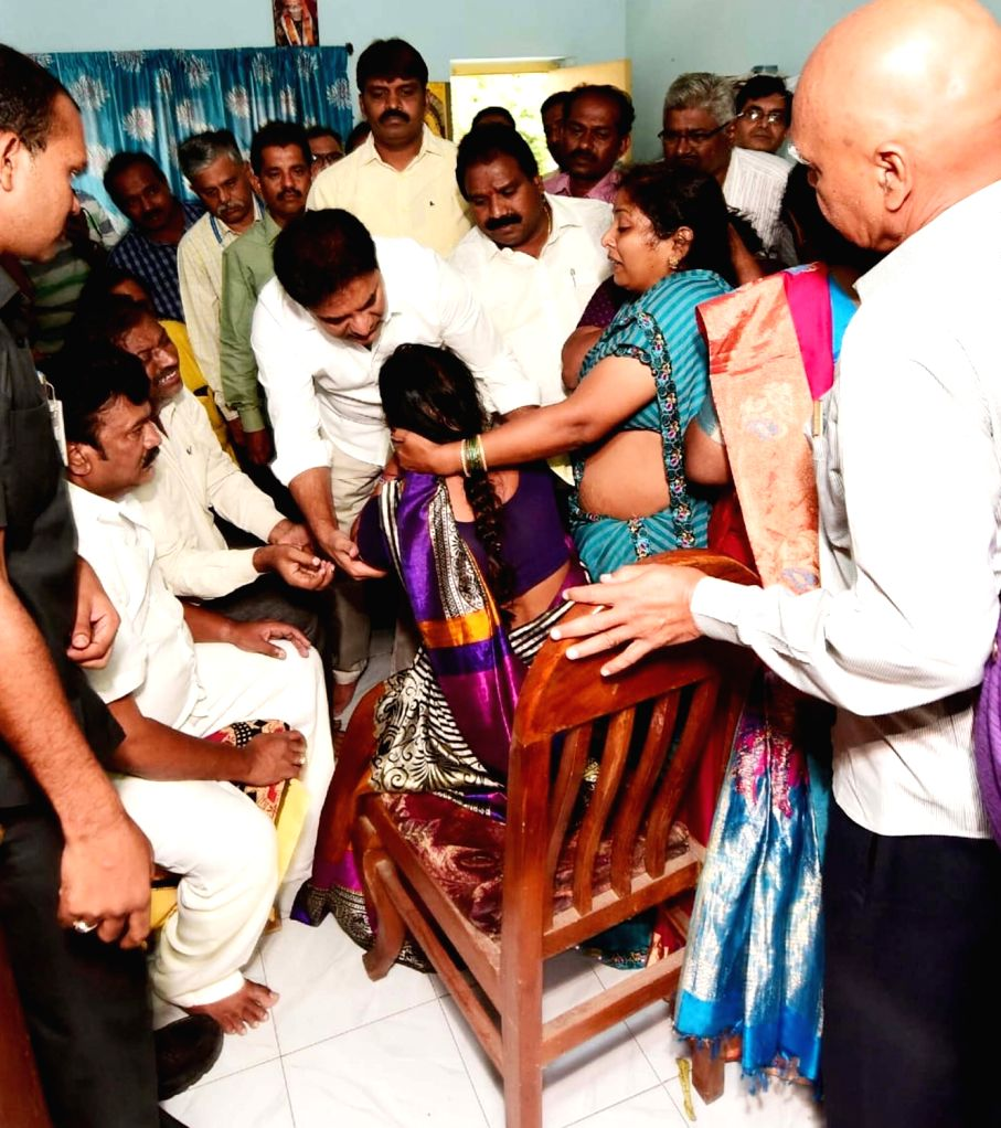 Telangana Cabinet Ministers K.T. Rama Rao and T. Srinivas Yadav console the family members of 26-year-old Indian student from Telangana, Sharath Koppu after he was shot dead inside a ... - K., T. Rama Rao and T. Srinivas Yadav
