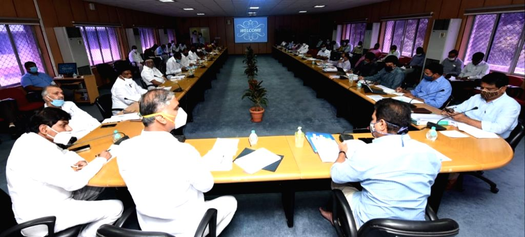 Telangana Cabinet Ministers KT Rama Rao and T. Harish Rao preside over a review meeting, in Hyderabad on July 11, 2020. - K and T. Harish Rao