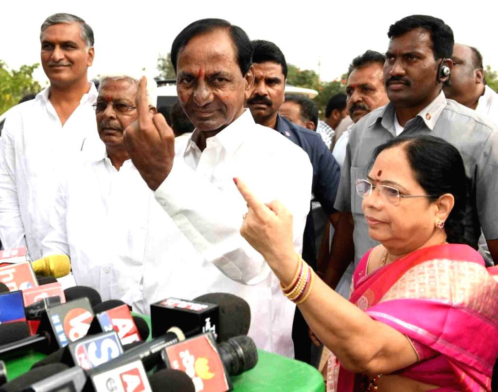 Telangana caretaker Chief Minister and TRS president K Chandrasekhar Rao and his wife K. Shobha show their inked fingers after casting their votes for Telangana Assembly elections in ... - K Chandrasekhar Rao