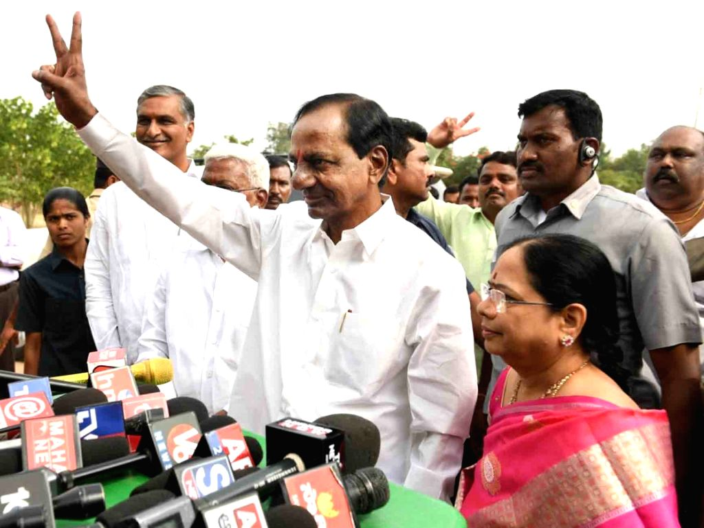 Telangana caretaker Chief Minister and TRS president K Chandrasekhar Rao accompanied by his wife K. Shobha shows victory sign after casting his vote for Telangana Assembly elections in ... - K Chandrasekhar Rao