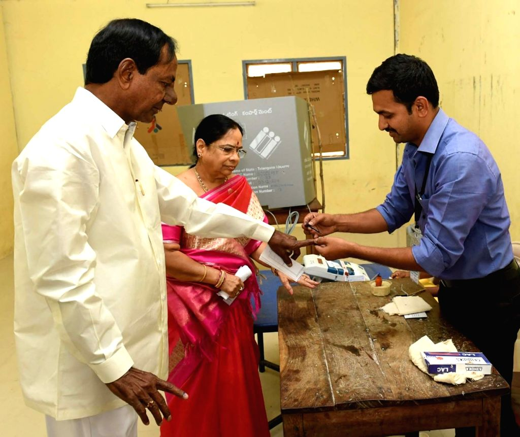 Telangana caretaker Chief Minister and TRS president K Chandrasekhar Rao and his wife K. Shobha, gets his finger marked with phosphoric ink after casting vote for Telangana Assembly ... - K Chandrasekhar Rao