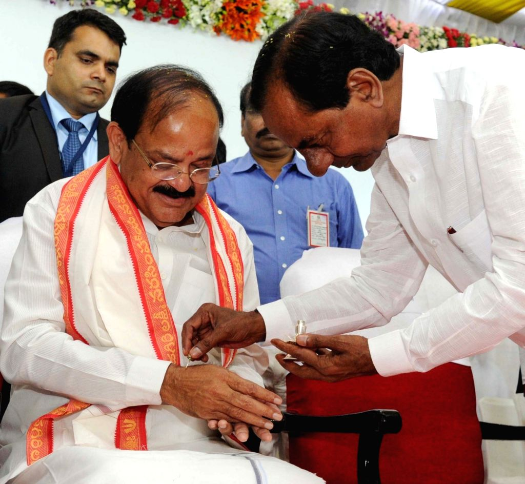 Telangana Cheif Minister K Chandershehar Rao welcomes Vice President M. Venkaiah Naidu during public felicitation ceremony organised by the state government at Raj Bhavan in Hyderabad on ... - K Chandershehar Rao and M. Venkaiah Naidu