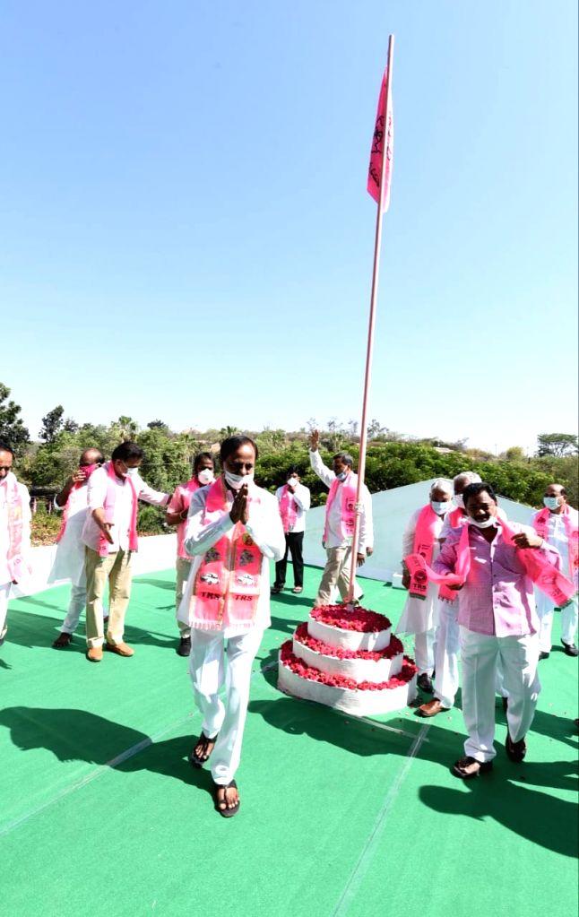 Telangana Chief Minister and Telangana Rashtra Samithi (TRS) President K. Chandrashekar Rao hoists the party's flag at the pary's headquarters at Telangana Bhavan in Hyderabad on the ... - K. Chandrashekar Rao