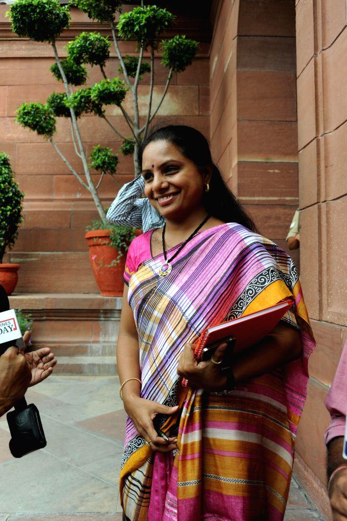 Telangana Chief Minister Chandrashekar Rao daughter of TRS MP K Kavitha at Parliament during the budget session on July 24, 2014. - Chandrashekar Rao