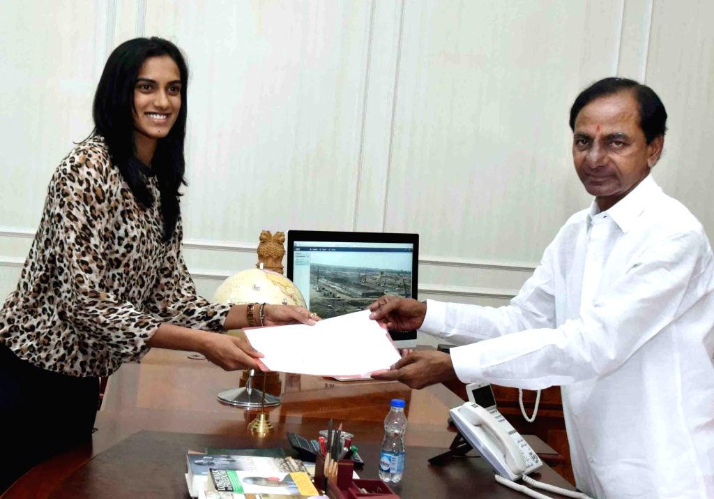 Telangana Chief Minister K Chandrasekhar Rao hands over 1000 square yards land to Olympic silver medallist PV Sindhu in Hyderabad on May 4, 2017. - K Chandrasekhar Rao