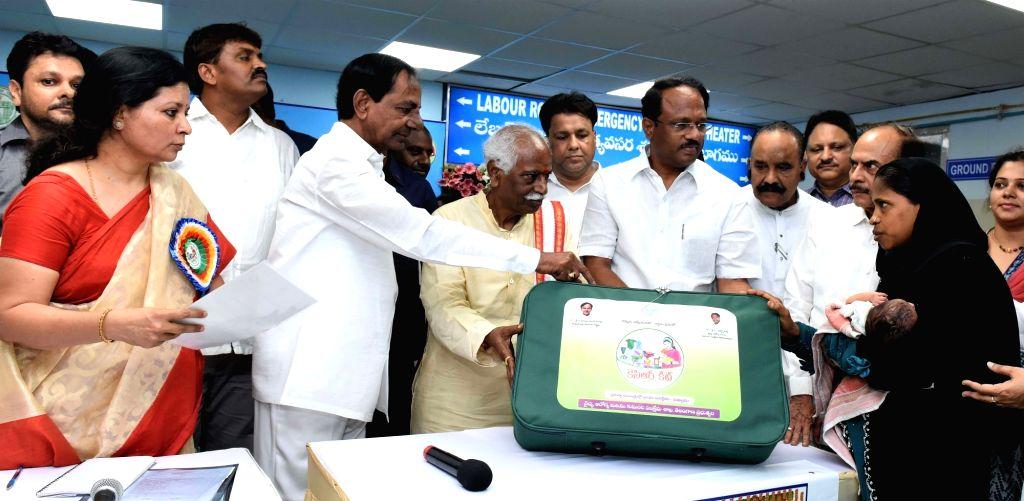 "Telangana Chief Minister K Chandrasekhar Rao presents ""KCR Kits"" to new mothers during a programme in Hyderabad on June 3, 2017. - K Chandrasekhar Rao"