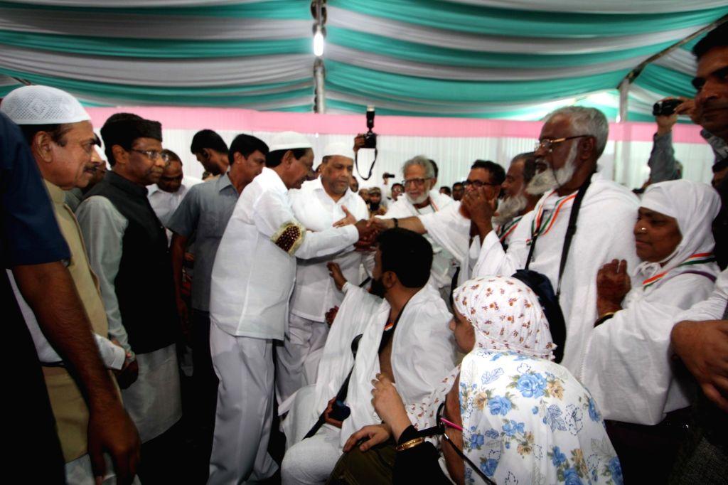 Telangana Chief Minister K Chandrasekhar Rao meets Haj pilgrims at Haj House in Hyderabad, on Aug 15, 2017. - K Chandrasekhar Rao