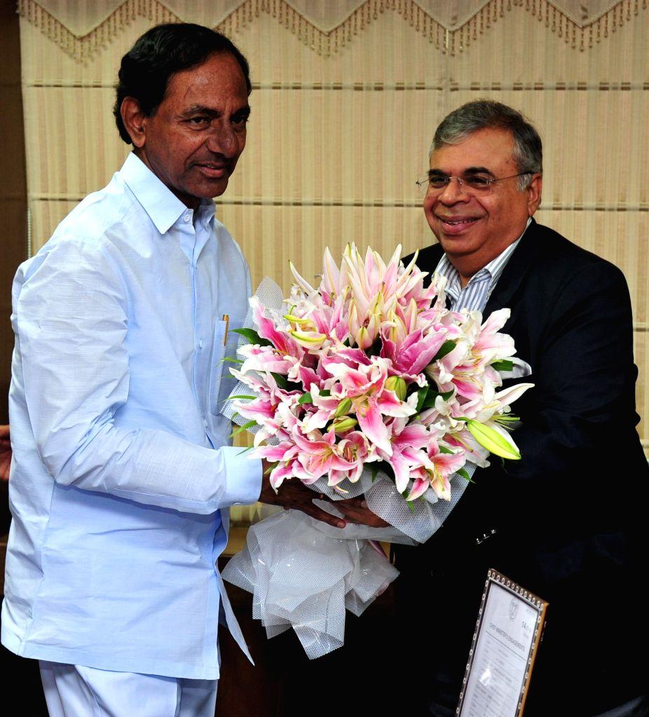 Telangana Chief Minister K Chandrasekhar Rao and Ashok Hinduja of Hinduja Group during a meeting in Hyderabad on July 14, 2014. - K Chandrasekhar Rao