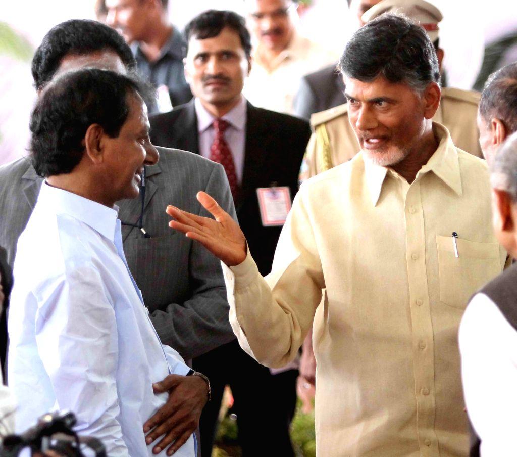 Telangana Chief Minister K Chandrasekhar Rao and Andhra Pradesh Chief Minister N. Chandra Babu Naidu receiving President Pranab Mukherjee at Begumpet Airport, Hyderabad on Aug. 2, 2014. - Pranab Mukherjee