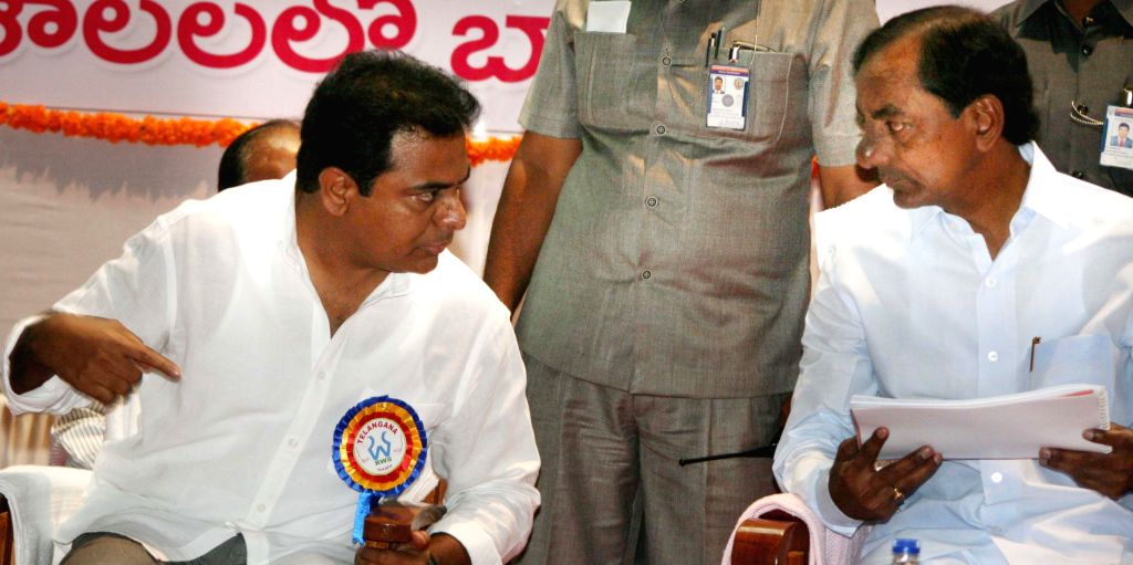Telangana Chief Minister K Chandrasekhar Rao and Telangana IT minister K T Rama Rao during a programme where he addressed engineers of Rural Water Supply Department at Jayashankar State Agricultural . - K Chandrasekhar Rao
