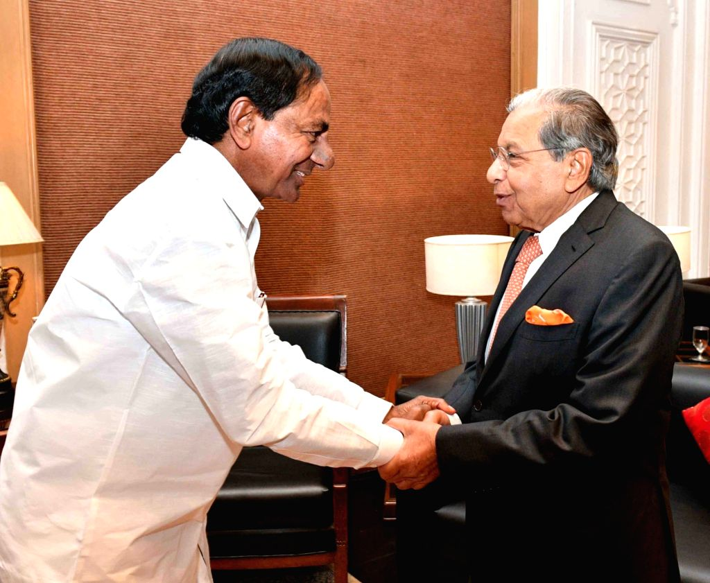 Telangana Chief Minister K Chandrasekhar Rao and 15th Finance Commission Chairman N K Singh during a meeting in Hyderabad on Feb 19, 2019. - K Chandrasekhar Rao and N K Singh