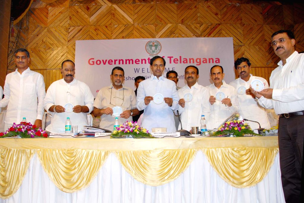 Telangana Chief Minister K Chandrasekhar Rao with district administration officials during a workshop on `Reinventing Telangana` in Hyderabad on July 7, 2014. - K Chandrasekhar Rao