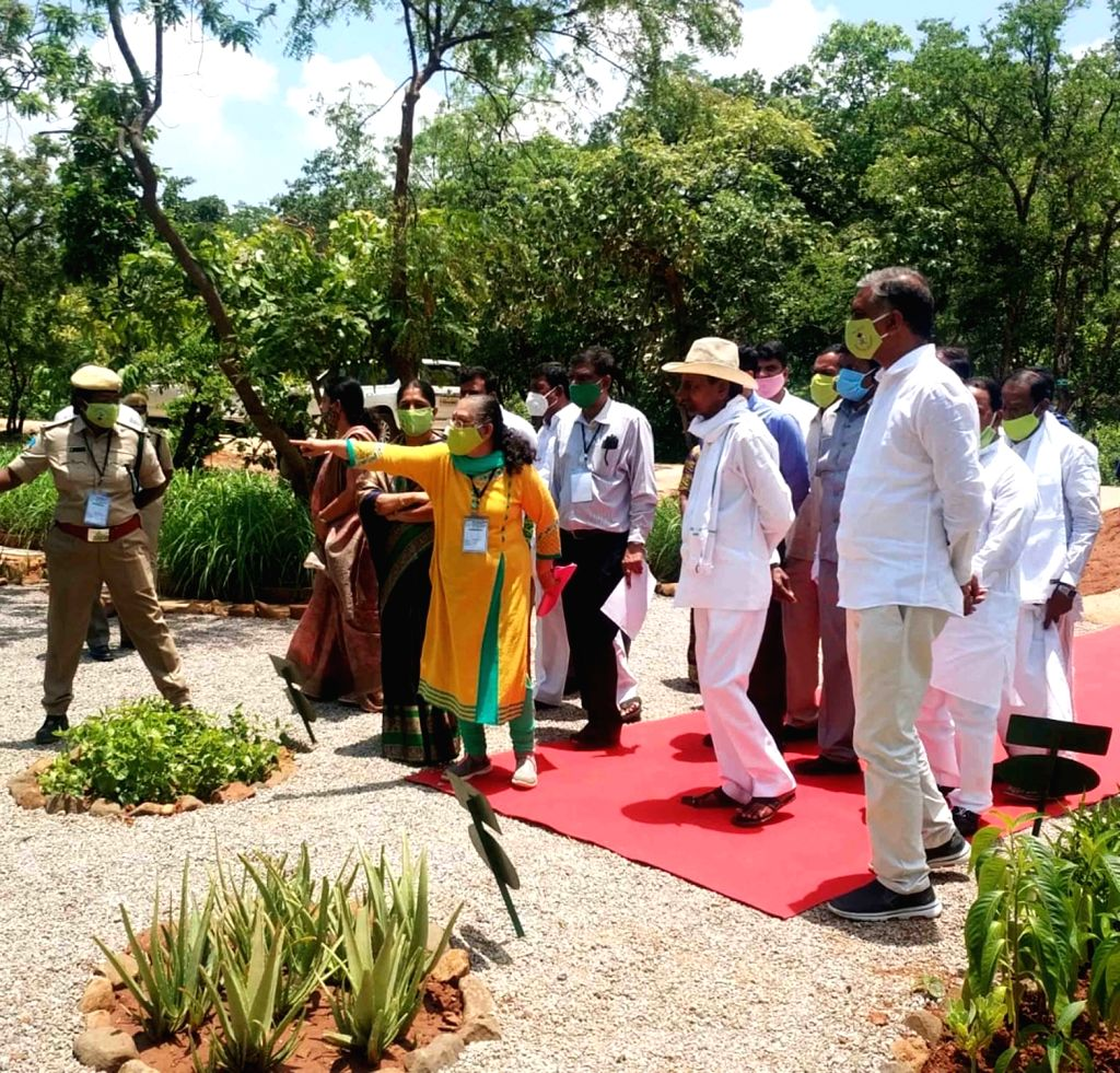 Telangana Chief Minister K. Chandrashekar Rao plants and waters a sapling as part of Narsapur forest revival programme and the sixth phase of Telanganaku Haritha Haram programme at urban ... - K. Chandrashekar Rao